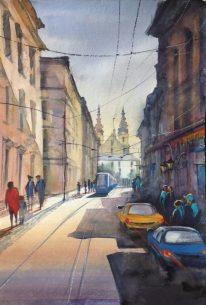 Stadsgezicht met tram en auto's