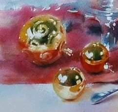 gouden kerstbalen op rode ondergrond